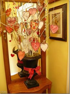 Maybe a little over the top, but I like the idea and especially love the handmade ornaments. Could definitely use this idea for Christmas which I think would be adorable.