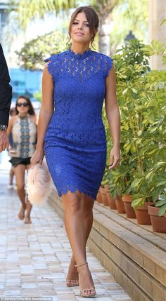 Blue babe: Chloe Lewis showed off her stunning curves in a blue lace shift dress