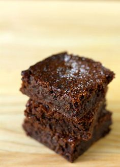 Dense and fudgy brownies -- with a layer of salted caramel baked right into the middle. Sprinkled with fleur de sel and coarse salt.