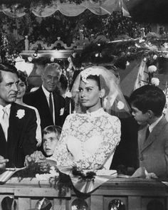 After famously falling in love on the set of The Pride and the Passion, Sophia Loren and Cary Grant's chemistry continued in this 1958 movie. And though the actors didn't end up together (Loren wed Carlo Ponti instead), their characters in Houseboat did, with Cinzia Zaccardi (Loren) wearing this wedding dress by Edith Head down the aisle. With its high neck, structured bodice, full skirt, and soutache on net overlay, the ball gown is giving us major Grace Kelly vibes. It was sold in a 2015…