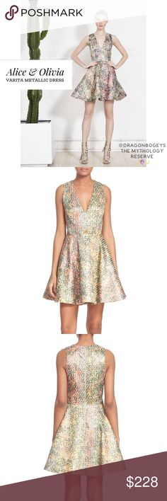 """Alice & Olivia Verita Metallic Dress Absolutely stunning metallic thread fit and flare dress with subtle cutouts at the waistline. V-neckline, sleeveless, two side slit pockets. Exposed back zipper with hook and eye closure. Textured fabric with metallic threading throughout gives the perfect amount of sparkle! Fully lined. Outer fabric is 33% polyester, 30% viscose, 20% cotton, 15% nylon, and 2% elastane. Lining is 94% polyester and 6% elastane. Length is 35"""", bust is 19"""" laid flat, waist…"""