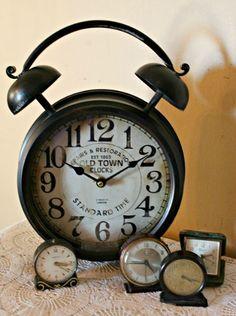 a collection of vintage alarm clocks
