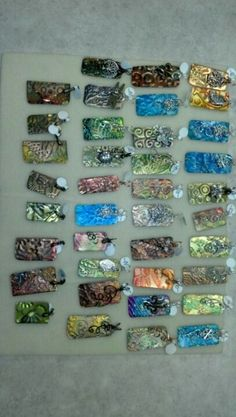 Alcohol inks on metal, tiles, glass.anything non porus. Love the endless possibilities. Alcohol Ink Jewelry, Alcohol Ink Crafts, Alcohol Ink Painting, Alcohol Ink Art, Grabar Metal, Metal Stamping, Jewelry Stamping, Metal Crafts, Distress Ink