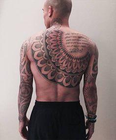 Nigel De Jong  Ornamental back piece tattoo on Nigel de Jong....