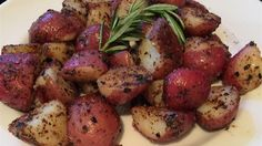 colorful combination of red, gold, and purple baby potatoes is pan ...