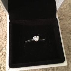 AUTHENTIC Pandora Silver Heart Ring AUTHENTIC Pandora Heart Shaped Ring in silver. Worn a handful of times, you can see the wear on the ring. It's a size 5.. True to size. Everything is still in tack. Bought originally at a freestanding Pandora Boutique Pandora Jewelry Rings