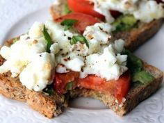 Open-faced breakfast sandwich with egg whites, avocado and tomato with fresh cracked pepper   sea salt