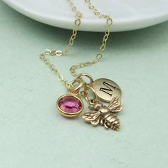 Gold Bee Necklace personalized with initial and custom birthstone by RoseAndRaven on Etsy https://www.etsy.com/uk/listing/238227283/gold-bee-necklace-personalized-with