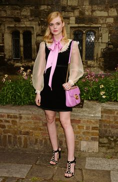 Actress Elle Fanning, wore a Gucci Fall Winter 2016 dress, organdy blouse, t-strap sandals with pearl embellishments, and the Marmont shoulder bag.
