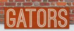 Show your schools spirit with this University of Florida Gators Wooden Sign. :: In all kinds of weather we stick together! :: www.WordsonWood.com