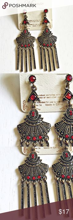 Treasured Royalty Earrings ❗️Brand New With Tags❗️Never Worn! These immaculate earrings are so intricately designed. Delicate detailing, red crystal accents & golden hardware make up these beauties. Add the perfect finishing touch to your wardrobe by wearing these Treasured Royalty Earrings. Truly eye-catching beauties & one of a kind additions to add to your jewelry collection:)❗️Depending on lighting the color can look lighter or darker:)❗️ Boutique Jewelry Earrings