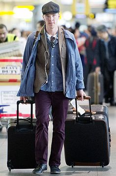 Encumber-batch - Encumber-batch Sherlock star Benedict Cumberbatch had his hands full with two rolling suitcases at New York City's JFK airport on April 30.