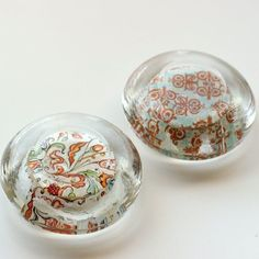DIY paperweights from glass candle holders  she says she fills them with resin and uses them upside down. I'd like the decoupage paper and something to look in top for- baby teeth, special stones...