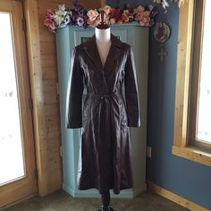 WILSON'S Long LEATHER Coat. WOW!! Beautiful long all leather coat w/removable belt. Button front. The color is a burgundy brown. Looks darker in the pics. Vey pretty color. The pics don't do this coat justice. It's been in my closet so it has a few wrinkles that will fall out. Coat has front pockets. It's has a black silk-like lining, no thermo lining. The coat is in excellent condition. No stains, no rips, no marks. The leather is soft & in excellent condition. No fading on the color. The…