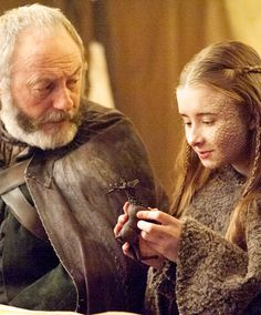 Tough Game of Thrones Trivia A touching moment between Ser Davos and the princess Shireen. A touching moment between Ser Davos and the princess Shireen. Davos, Winter Is Here, Winter Is Coming, Game Of Thrones 5, Got Merchandise, Game Of Trone, Liam Cunningham, Plus Tv, The North Remembers