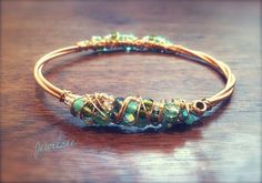 Recycled GUITAR STRING Bracelet Adorned with di DesignsByJewelree