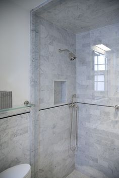 nyc pre war paradise designed by joan chan aia master bathroom in carrara honed
