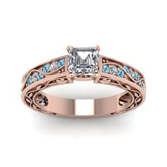 Antique Scroll Asscher Cut diamond Side Stone Engagement Rings with Ice Blue Topaz in 14K Rose Gold exclusively styled by Fascinating Diamonds