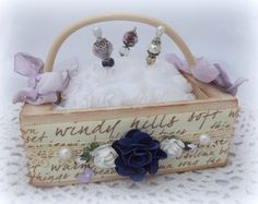 A wooden basket pin cushion I made which is available in my etsy shop.