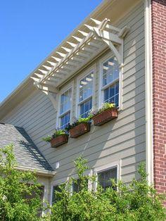 pergola over second floor window! awesome idea