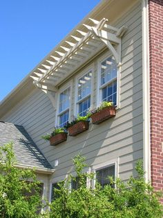 pergola over second floor window! awesome idea