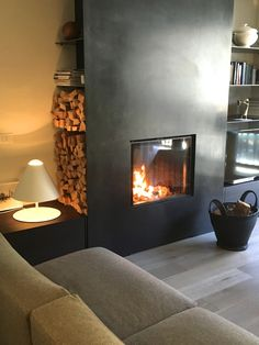 A contemporary apartment in the mountains - black metal fireplace range ships canape verzelloni contemporary apartment mountains dolomites italy madonna di campiglio Metal Fireplace, Home Fireplace, Fireplace Surrounds, Fireplace Design, Black Fireplace, Design Home App, Küchen Design, House Design, Interior Design