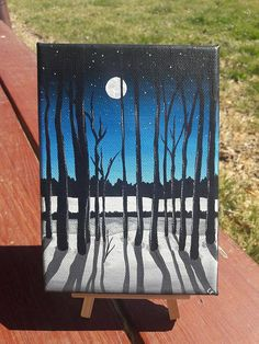 Reminiscent of a cool winter night as the shadows of the trees streak the snow. This stretched canvas measures 5 x 7 and is ready to hang.