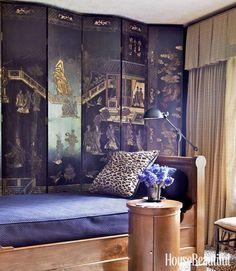 Will Merrill - House Beautiful A Coromandel screen takes center stage in this elegant guest room with a sleek day bed and leopard rug and pillows. #LuxuryBeddingPurple