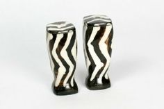 Maisha Eco-Friendly Batik Bone Zig Zag Salt & Pepper Shakers,Fair Trade,Africa by Patricia. $9.95. Handcrafted for stunning styles, unique details on each piece; water- and stain-resistant. Handcrafted using Fair Trade practices to protect and sustain the Africa artisans.. Wash by hand and air dry. Durable, resinous horn with trendy African authentic designs with a foam plug on the bottom for easy refilling. Great for sprucing up the table. Whether you're looking f...