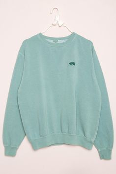 "Relaxed fit blended cotton pullover sweatshirt in a stonewashed green with a crewneck front and small dark green bear embroidery on the left chest. 27"" length, 23"" bust Made In USA Color: Green"