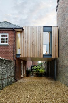 British architect Adam Knibb has extended a house in a converted school in Winchester, England, by building a timber box above a seldom-used entryway.Adam Knibb Architects was asked by the owner to … Architecture Extension, Residential Architecture, Interior Architecture, Interior Design, Wooden Cladding, Wooden Slats, Architects Journal, Extension Designs, Extension Ideas