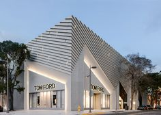 Aranda\Lasch adds pleated concrete facade to Tom Ford store.