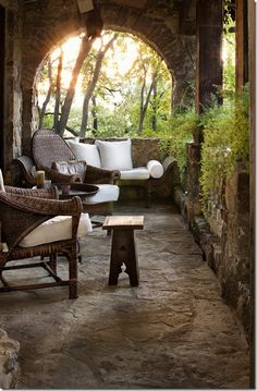 beautiful stone porch: I want that    This is a great porch, where you can really relax.