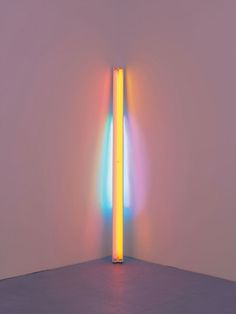 Dan Flavin, untitled,1978, pink, yellow, green, and blue fluorescent light, 8 ft. (244 cm) high.