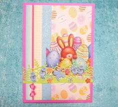 HANDMADE EASTER CARD - Bunny and eggs with touches of gold foil and sparkle and a lacy, intricate border of flowers and bluebirds