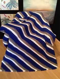 Corner to Corner afghan made to represent The University of St. Francis. Colors are Blue, Gray and White. This is where I got the pattern: http://thecrochetcrowdblog.com/2013/06/08/crochet-corner-to-corner-afghan-project-youtube/