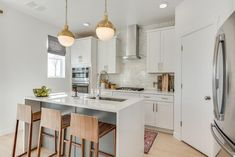 White and gray kitchen with gold accents