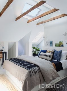 H&H's Reiko Caron shows us how one family turned their dark, unused attic into a bright, welcoming bedroom. | Photo: Jason Stickley
