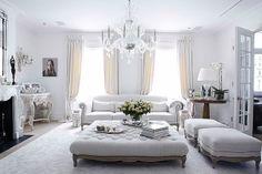 Stunning white living room, chandelier, high ceilings