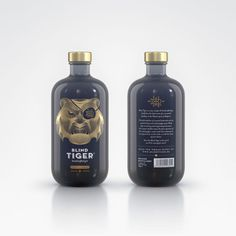 blind tiger - Deluxe Distillery created the labels for the Blind Tiger Gin, which reveals a golden tiger's face wearing an eye patch atop a navy blue bottl...