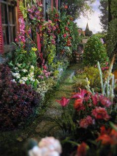 "Studio E: ""IN AN ENGLISH COUNTRY GARDEN"" Yes. This is a dollhouse garden. Incredible!"