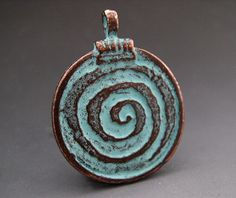 Hey, I found this really awesome Etsy listing at https://www.etsy.com/listing/97768811/copper-green-spiral-of-life-pendant-30mm