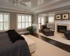 Bedroom with fireplace and plantation shutters - walls are a muted soft gray and trim a crisp pure white