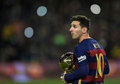 Barcelona's Argentinian forward Lionel Messi walks away after posing with his fifth Ballon d'Or trophy before the Spanish league football match FC Barcelona vs Athletic Club Bilbao at the Camp Nou stadium in Barcelona on January 17, 2016.