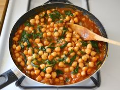 Curried Chickpeas with Spinach - Budget Bytes. I made with fire roster diced tomatoes and it was still really good. Next time add white beans?