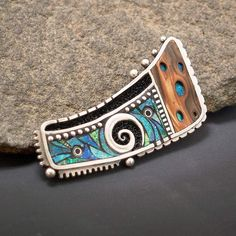 I new pin or pendant I completed in Sterling silver MC inlaid with polymer clay.
