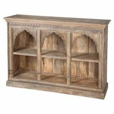 """Perfect as a catch-all in the entry or holding curios in the den, this handsome wood bookcase showcases arched openings and a molded trim.  Product: BookcaseConstruction Material: Solid mango woodColor: NaturalFeatures:  Four open shelvesArch-inspired designDimensions: 42"""" H x 62"""" W x 15"""" D"""