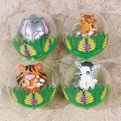 """Inflatable Zoo Animals In Beach Balls. These vinyl balls are fun to throw around at the beach or in your backyard! Featuring elephants, giraffes and other fun jungle animals, these balls make excellent favors at a summer pool party! Inflated, approx. 11""""; deflated, 14"""". © OTC"""
