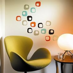 Love these googie mid-century-look wall decals and the furniture.