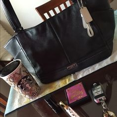 Coach purse, large, previously loved Black soft leather authentic Coach purse.  I used this purse quite a bit.  There are no outward signs of use.  The leather is soft and forgiving.  There are stains from leaky lipgloss that is pictured.  A beautiful bag, otherwise.  The inside material is real green. Coach Bags